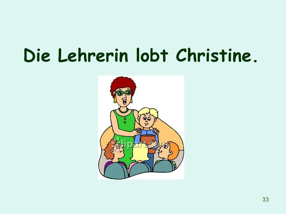 33 Die Lehrerin lobt Christine.