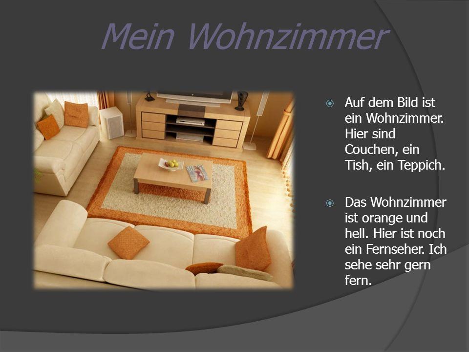 Mein Wohnzimmer Auf dem Bild ist ein Wohnzimmer. Hier sind Couchen, ein Tish, ein Teppich. Das Wohnzimmer ist orange und hell. Hier ist noch ein Ferns