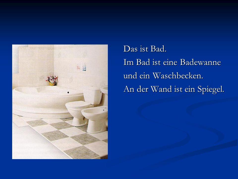 Das ist Bad. Im Bad ist eine Badewanne und ein Waschbecken. An der Wand ist ein Spiegel.