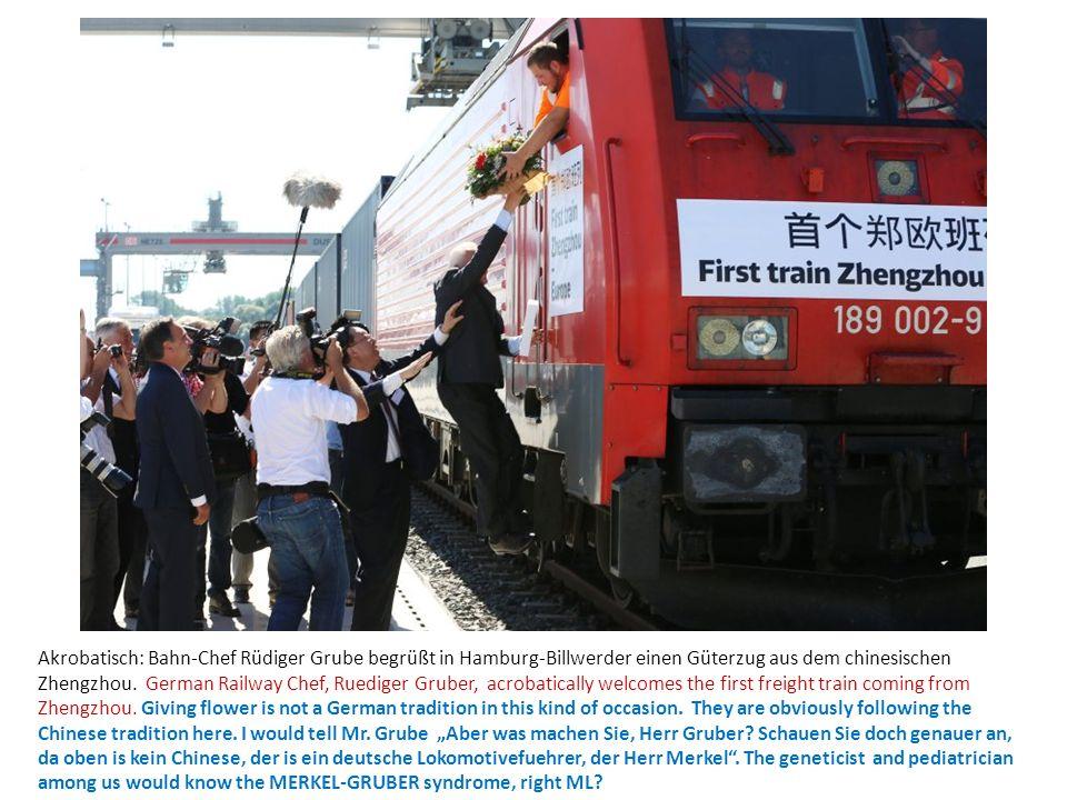 Akrobatisch: Bahn-Chef Rüdiger Grube begrüßt in Hamburg-Billwerder einen Güterzug aus dem chinesischen Zhengzhou. German Railway Chef, Ruediger Gruber