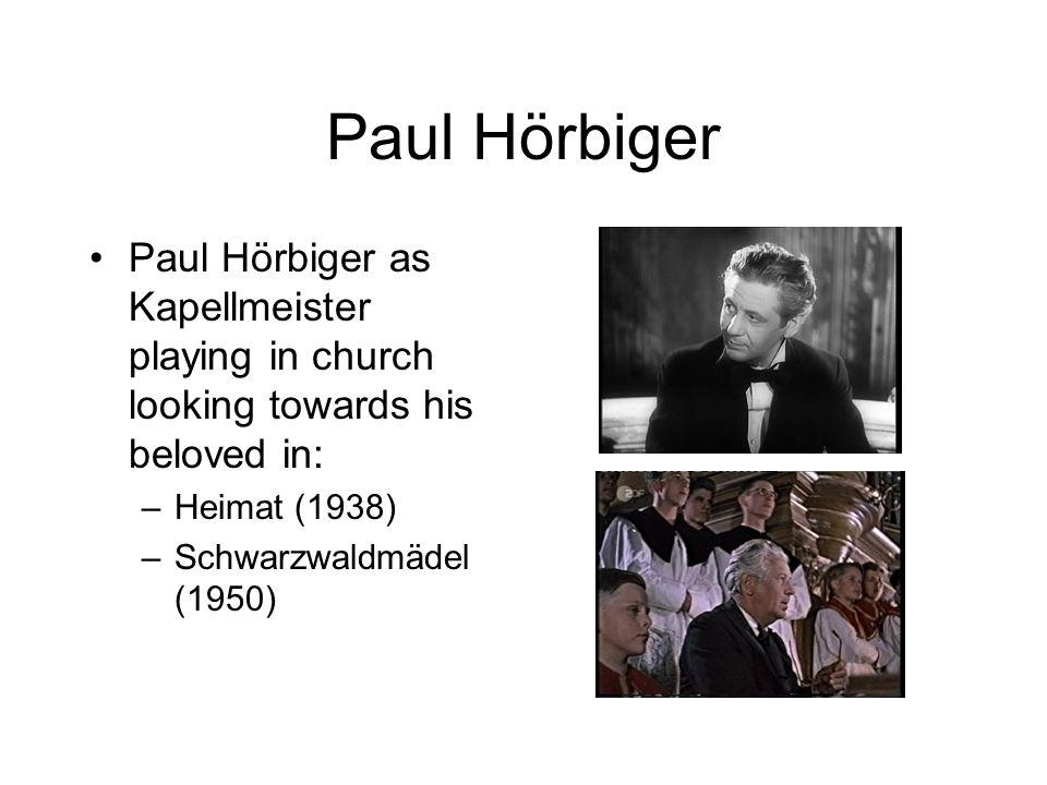 Paul Hörbiger Paul Hörbiger as Kapellmeister playing in church looking towards his beloved in: –Heimat (1938) –Schwarzwaldmädel (1950)