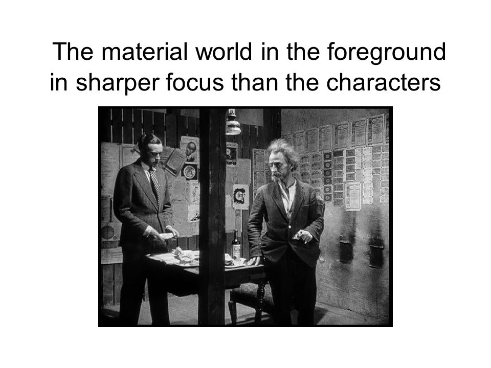 The material world in the foreground in sharper focus than the characters