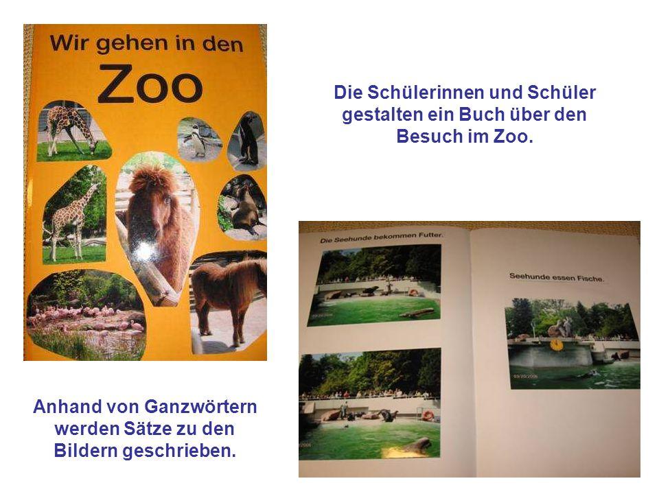 Die Schülerinnen und Schüler gestalten ein Buch über den Besuch im Zoo. Anhand von Ganzwörtern werden Sätze zu den Bildern geschrieben.