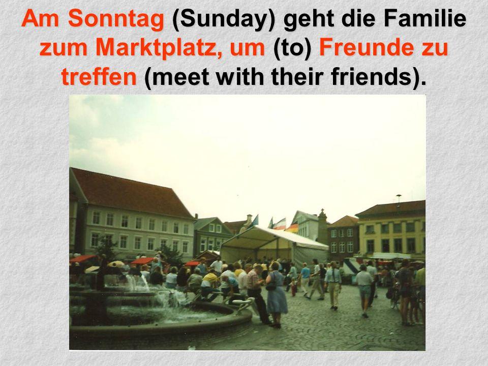 Am Sonntag (Sunday) geht die Familie zum Marktplatz, um (to) Freunde zu treffen (meet with their friends).