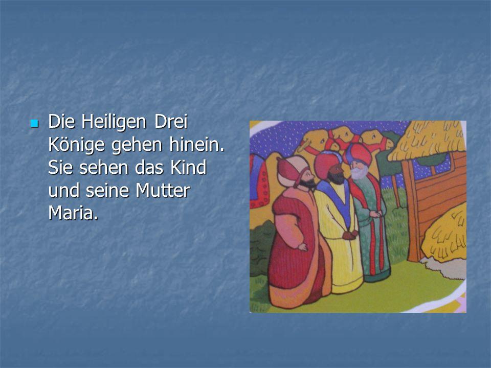 Die Heiligen Drei Könige gehen hinein. Sie sehen das Kind und seine Mutter Maria. Die Heiligen Drei Könige gehen hinein. Sie sehen das Kind und seine