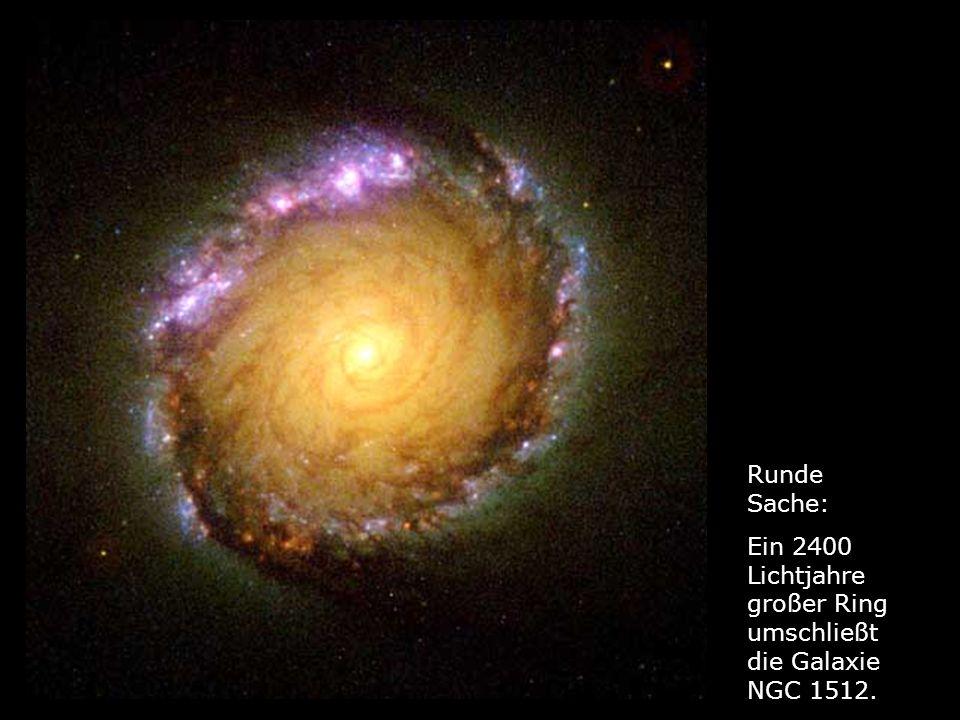 Runde Sache: Ein 2400 Lichtjahre großer Ring umschließt die Galaxie NGC 1512.
