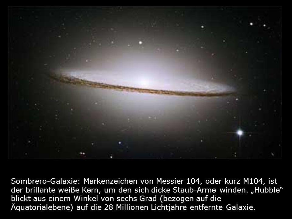 Sombrero-Galaxie: Markenzeichen von Messier 104, oder kurz M104, ist der brillante weiße Kern, um den sich dicke Staub-Arme winden. Hubble blickt aus