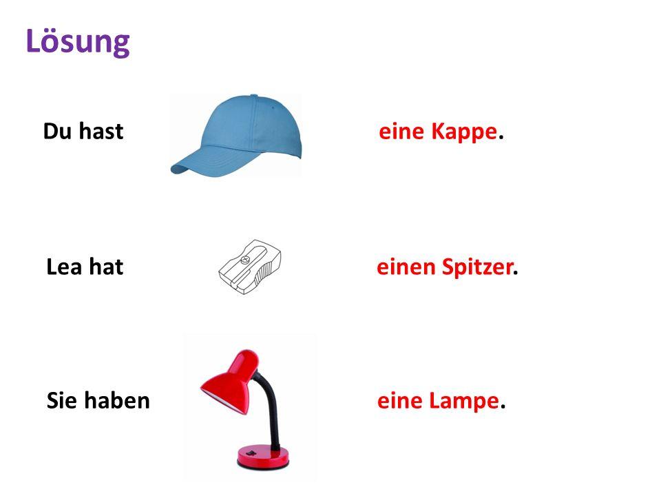 Du hast eine Kappe. Lea hat einen Spitzer. Sie haben eine Lampe. Lösung