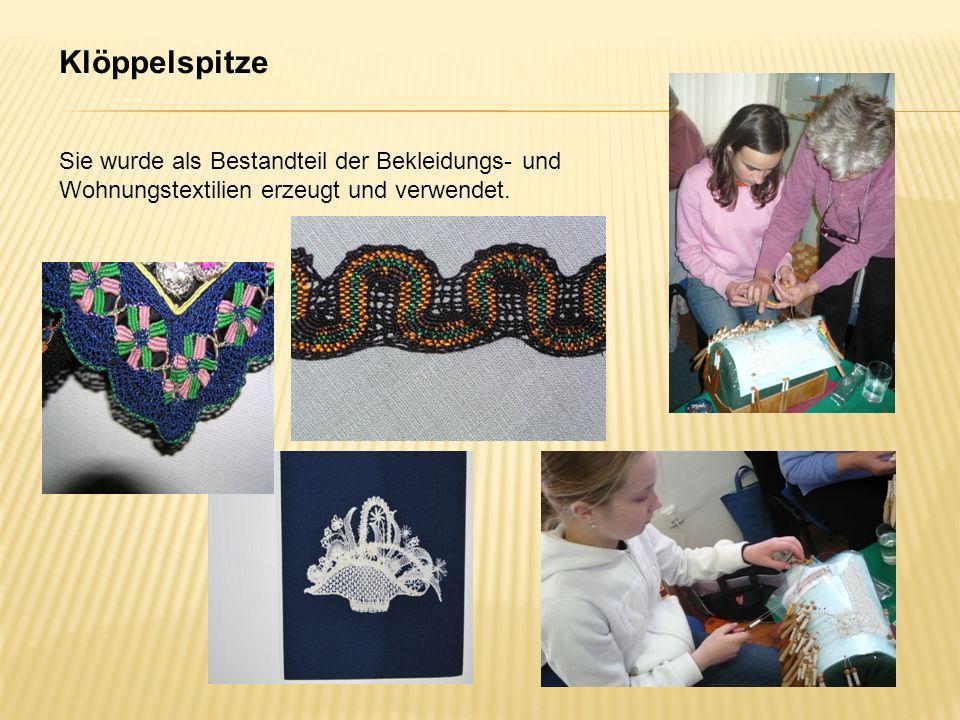 Klöppelspitze Sie wurde als Bestandteil der Bekleidungs- und Wohnungstextilien erzeugt und verwendet.