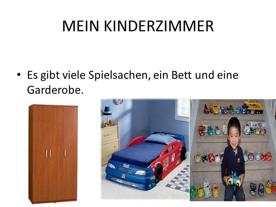 MEIN KINDERZIMMER Es gibt viele Spielsachen, ein Bett und eine Garderobe.