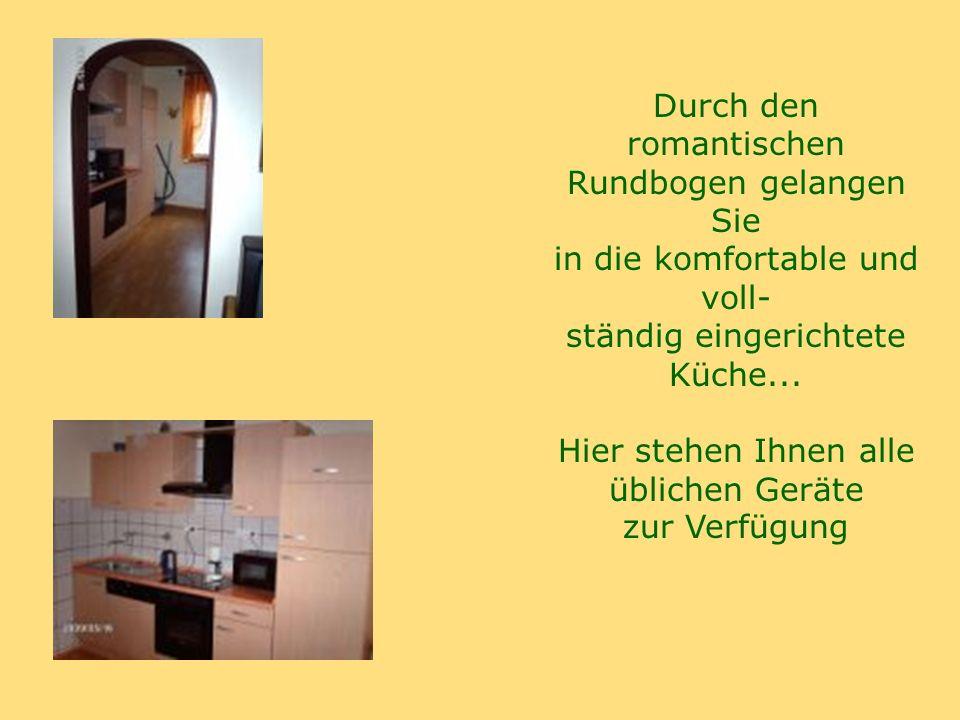 Durch den romantischen Rundbogen gelangen Sie in die komfortable und voll- ständig eingerichtete Küche...