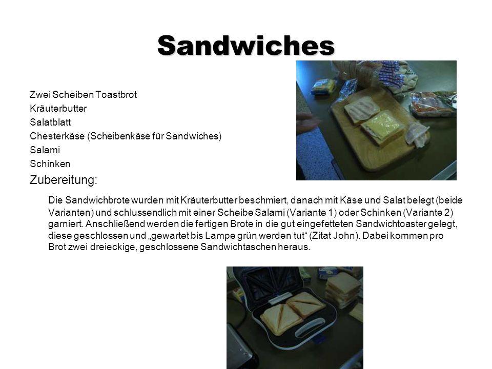 Sandwiches Zwei Scheiben Toastbrot Kräuterbutter Salatblatt Chesterkäse (Scheibenkäse für Sandwiches) Salami Schinken Zubereitung: Die Sandwichbrote wurden mit Kräuterbutter beschmiert, danach mit Käse und Salat belegt (beide Varianten) und schlussendlich mit einer Scheibe Salami (Variante 1) oder Schinken (Variante 2) garniert.