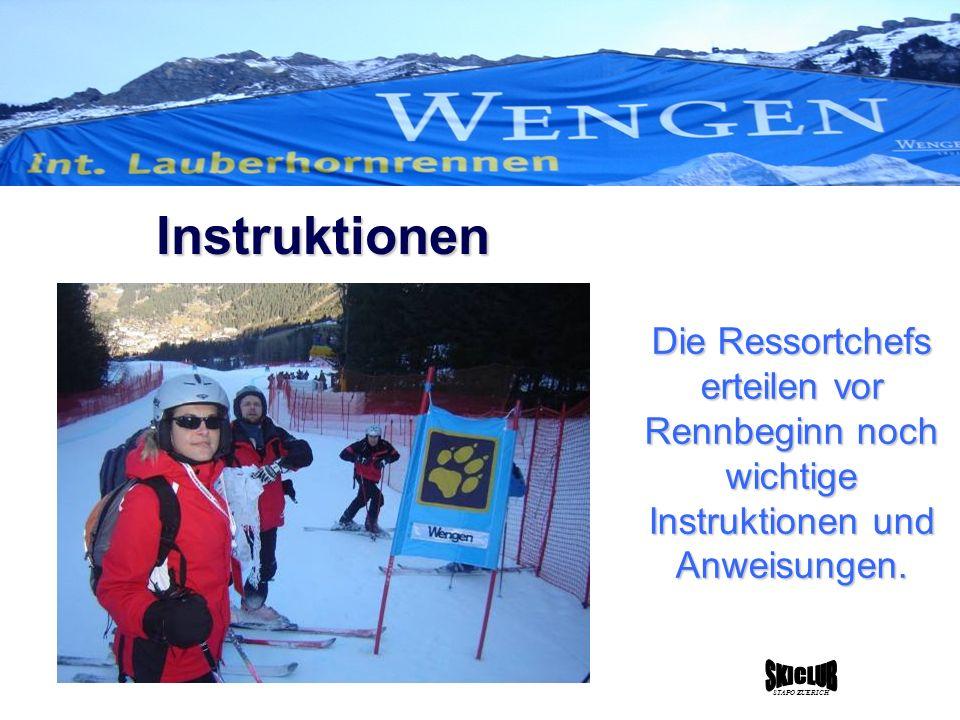 Die Ressortchefs erteilen vor Rennbeginn noch wichtige Instruktionen und Anweisungen.
