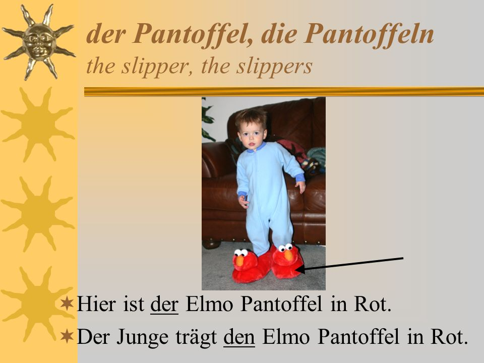 der Pantoffel, die Pantoffeln the slipper, the slippers Hier ist der Elmo Pantoffel in Rot. Der Junge trägt den Elmo Pantoffel in Rot.