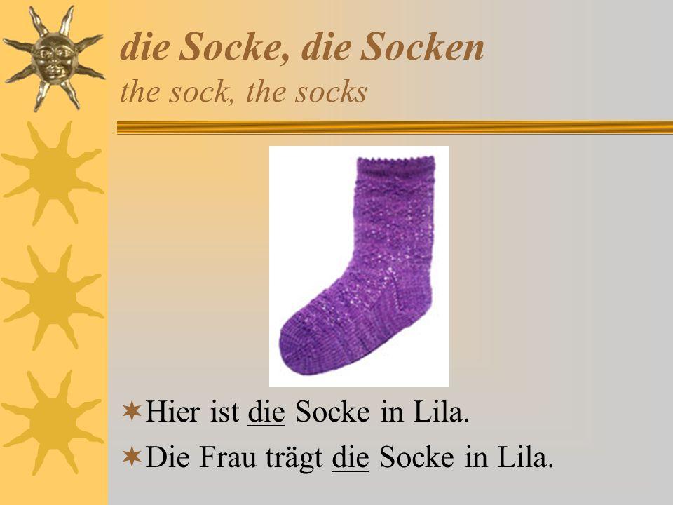 die Socke, die Socken the sock, the socks Hier ist die Socke in Lila. Die Frau trägt die Socke in Lila.