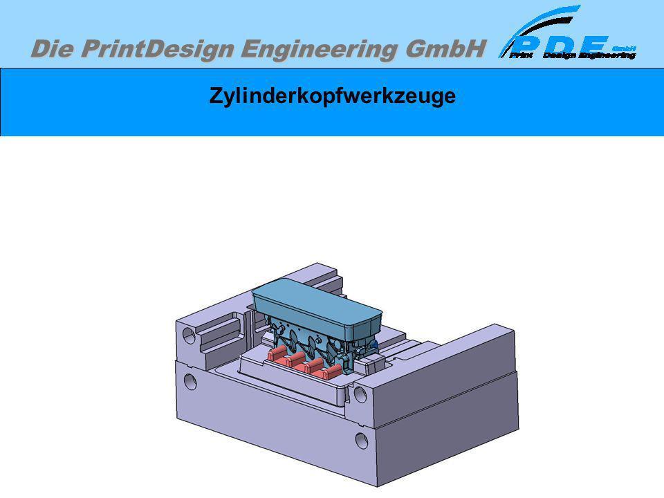 Die PrintDesign Engineering GmbH Zylinderkopfwerkzeuge Werkzeugunterteil dargestellt mit Gußteil und den Sandkernen.