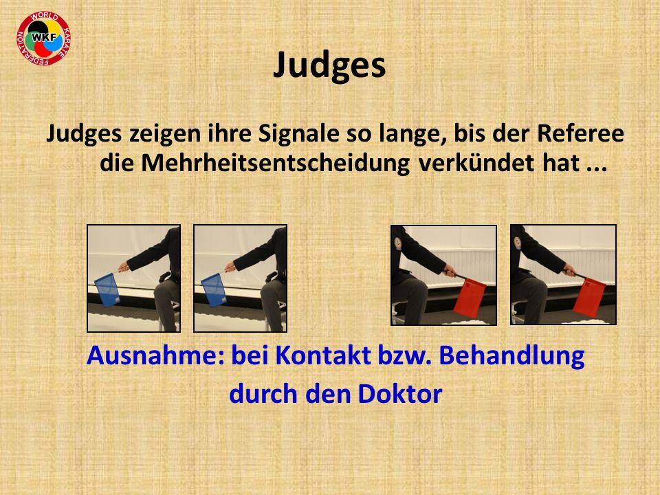 Judges zeigen ihre Signale so lange, bis der Referee die Mehrheitsentscheidung verkündet hat... Ausnahme: bei Kontakt bzw. Behandlung durch den Doktor