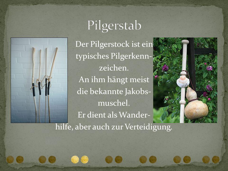 Der Pilgerstock ist ein typisches Pilgerkenn- zeichen. An ihm hängt meist die bekannte Jakobs- muschel. Er dient als Wander- hilfe, aber auch zur Vert