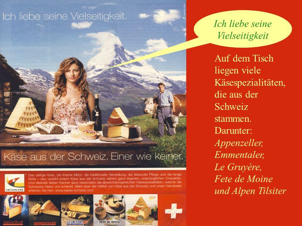 Auf dem Tisch liegen viele Käsespezialitäten, die aus der Schweiz stammen.