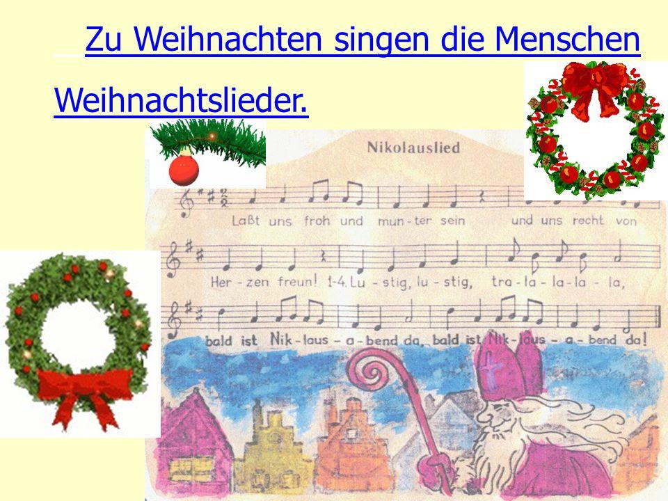 Zu Weihnachten singen die Menschen Weihnachtslieder.