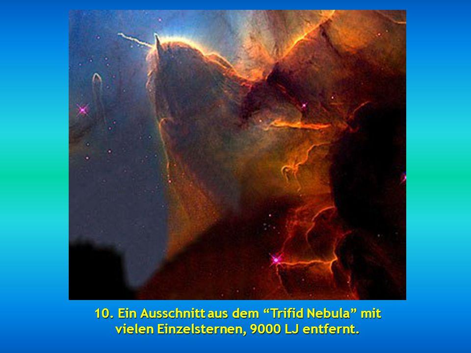 9. Die beiden 114 Millionen Lichtjahre entfernten Spiral-Galaxien NGC 2207 und IC 2163, die in einer Kollision verschmelzen.