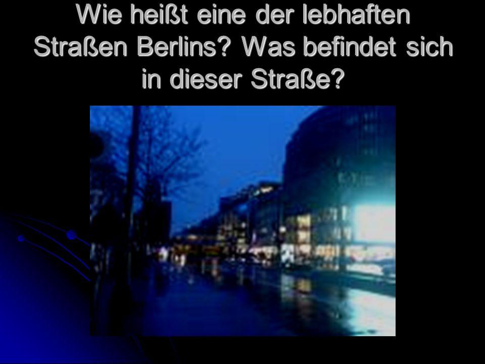 Wie heißt eine der lebhaften Straßen Berlins? Was befindet sich in dieser Straße?