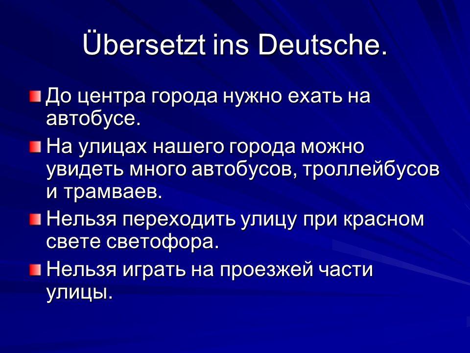 Übersetzt ins Deutsche. До центра города нужно ехать на автобусе.