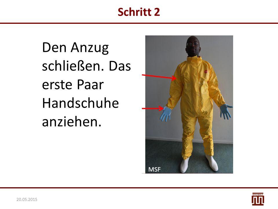 Schritt 2 Den Anzug schließen. Das erste Paar Handschuhe anziehen. MSF 20.05.2015