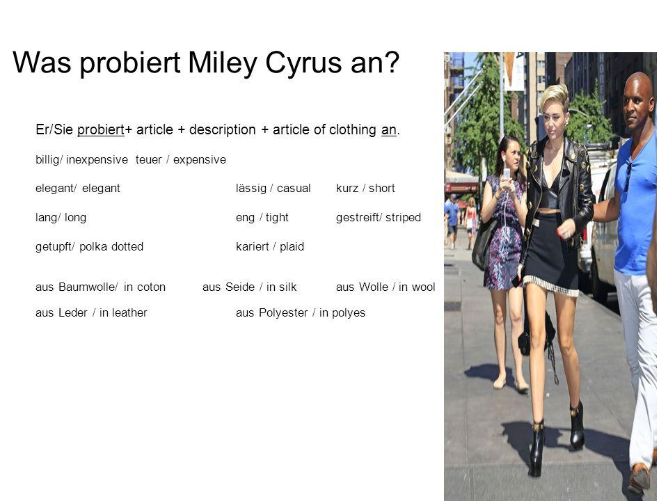 Was probiert Miley Cyrus an.Er/Sie probiert+ article + description + article of clothing an.