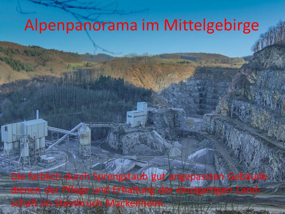 Alpenpanorama im Mittelgebirge Die farblich durch Sprengstaub gut angepassten Gebäude dienen der Pflege und Erhaltung der einzigartigen Land- schaft i