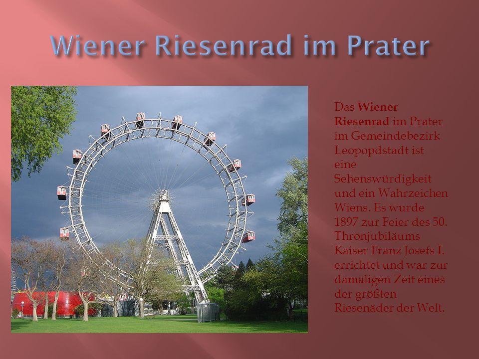 Das Wiener Riesenrad im Prater im Gemeindebezirk Leopopdstadt ist eine Sehenswürdigkeit und ein Wahrzeichen Wiens.