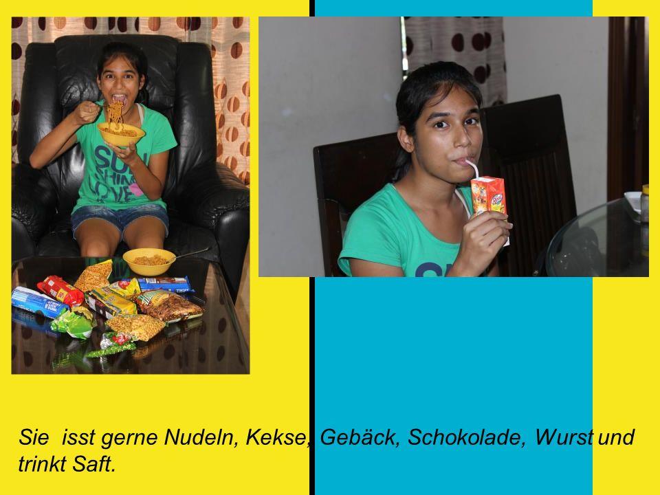 Sie isst gerne Nudeln, Kekse, Gebäck, Schokolade, Wurst und trinkt Saft.
