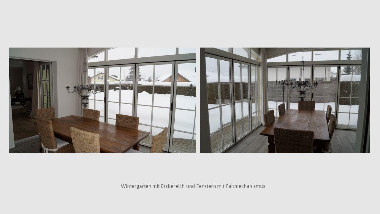 Wintergarten mit Essbereich und Fenstern mit Faltmechanismus