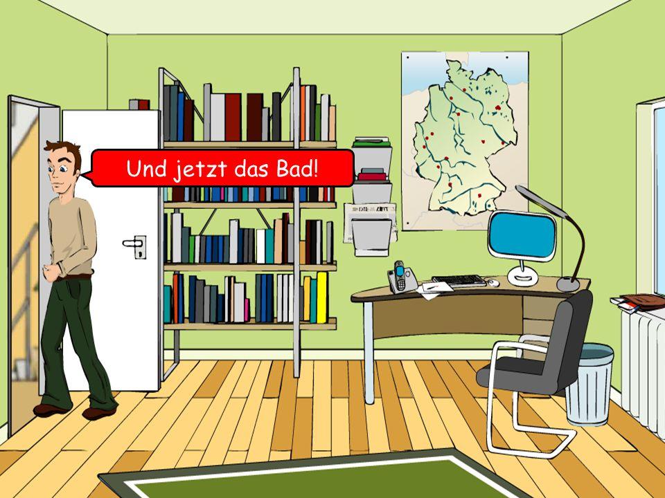 der Computer der Schreibtisch das Telefon der Teppich die Bücher