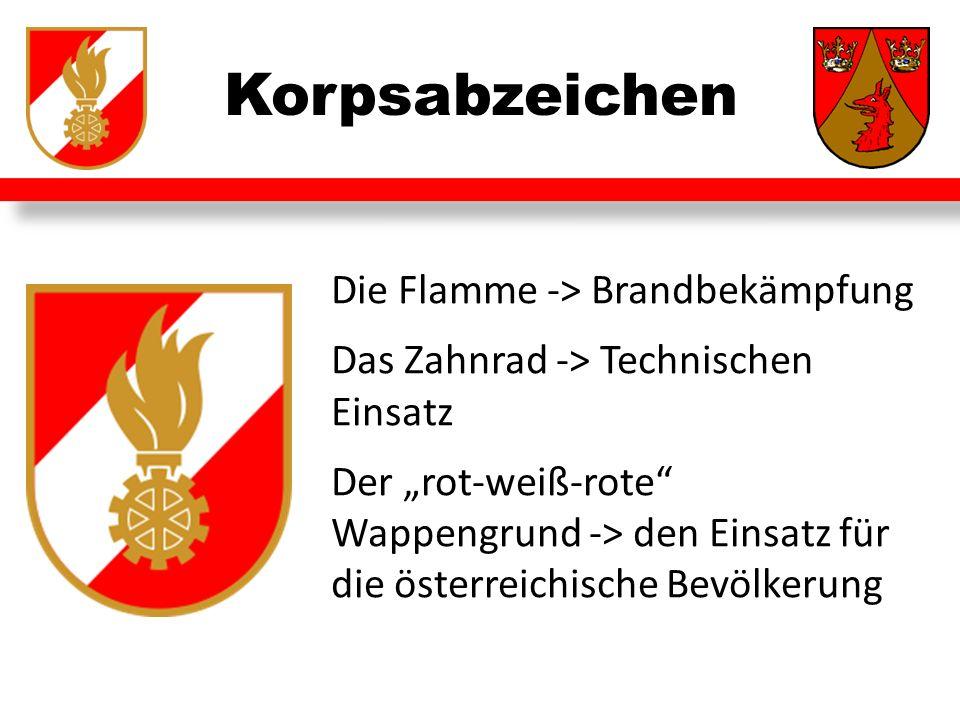 """Korpsabzeichen Die Flamme -> Brandbekämpfung Das Zahnrad -> Technischen Einsatz Der """"rot-weiß-rote Wappengrund -> den Einsatz für die österreichische Bevölkerung"""