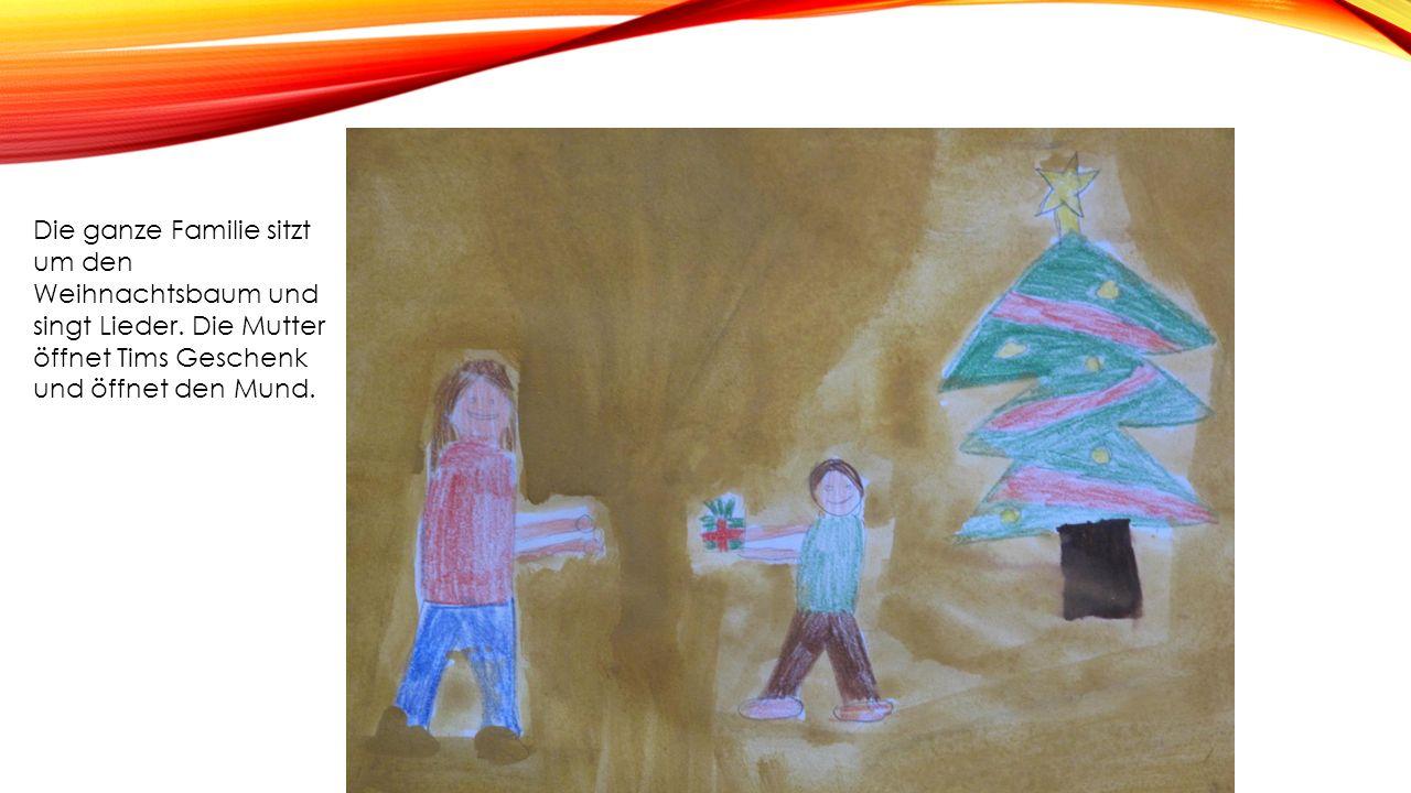 Die ganze Familie sitzt um den Weihnachtsbaum und singt Lieder.