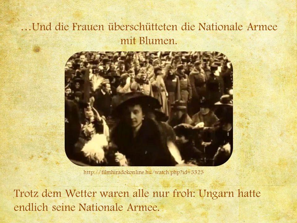 …Und die Frauen überschütteten die Nationale Armee mit Blumen.