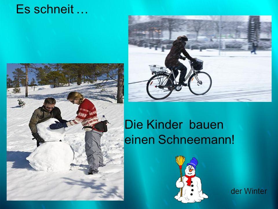 Es schneit … Die Kinder bauen einen Schneemann! der Winter