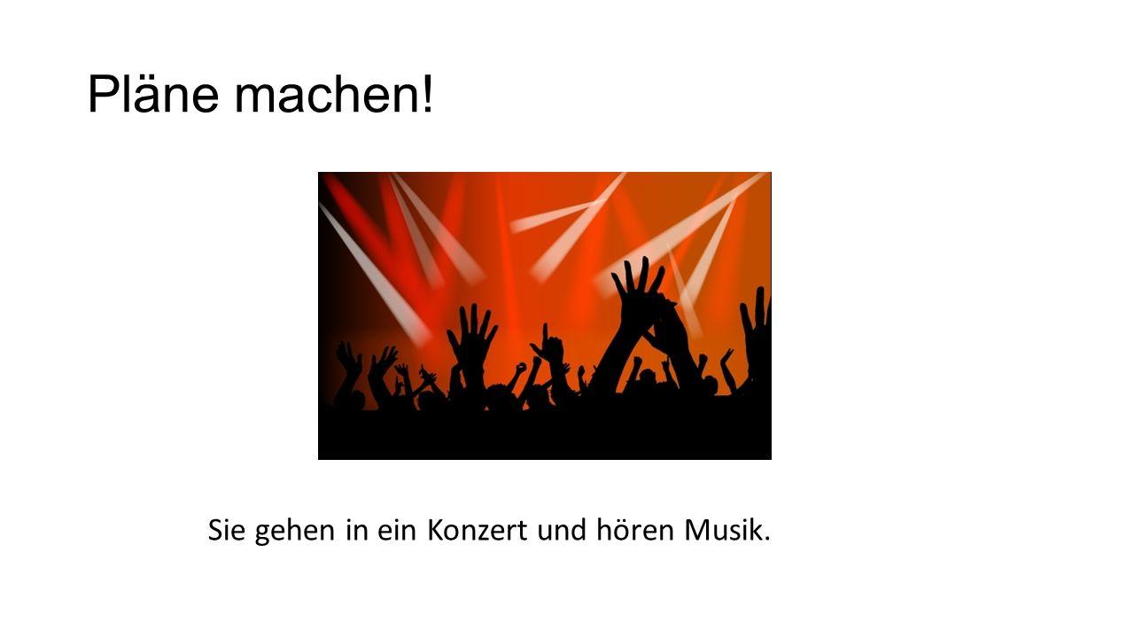 Pläne machen! Sie gehen in ein Konzert und hören Musik.