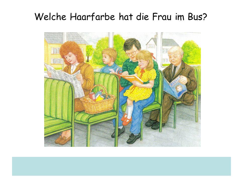 Welche Haarfarbe hat die Frau im Bus?