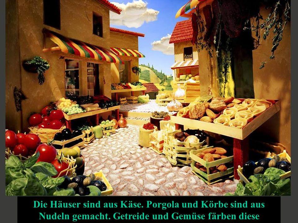 Die Häuser sind aus Käse. Porgola und Körbe sind aus Nudeln gemacht.