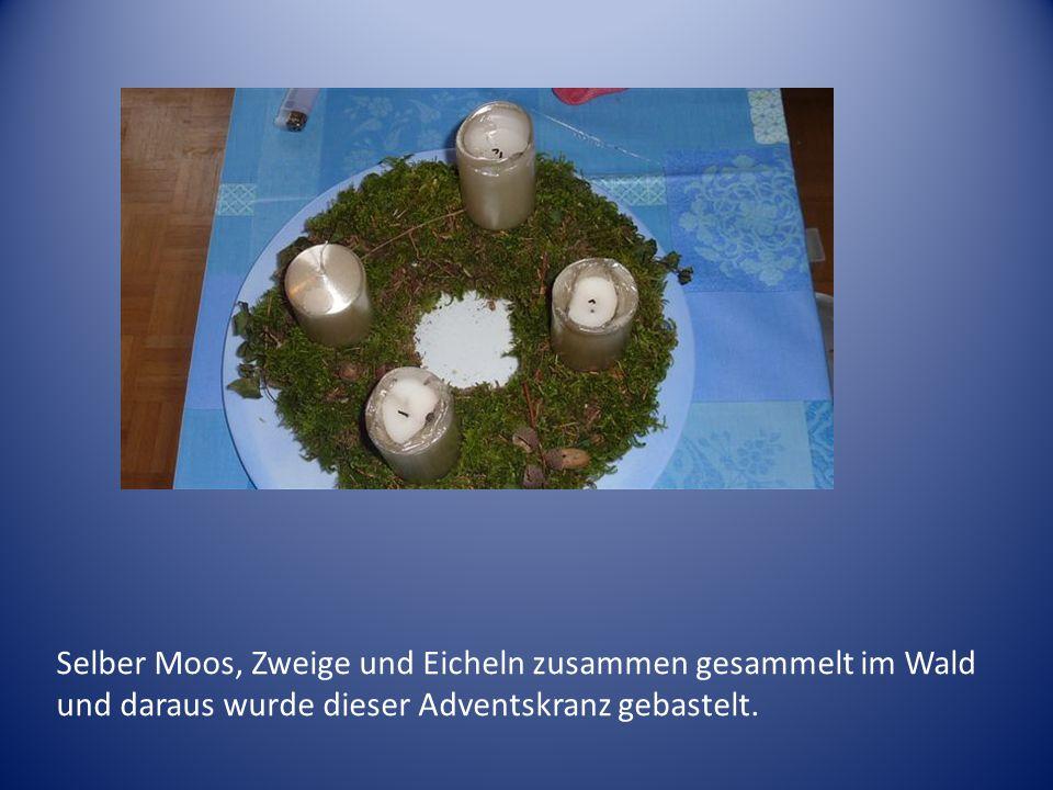 Selber Moos, Zweige und Eicheln zusammen gesammelt im Wald und daraus wurde dieser Adventskranz gebastelt.