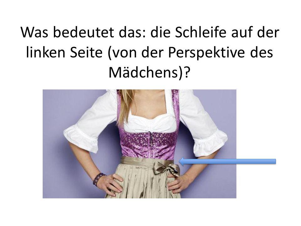 Was bedeutet das: die Schleife auf der linken Seite (von der Perspektive des Mädchens)?
