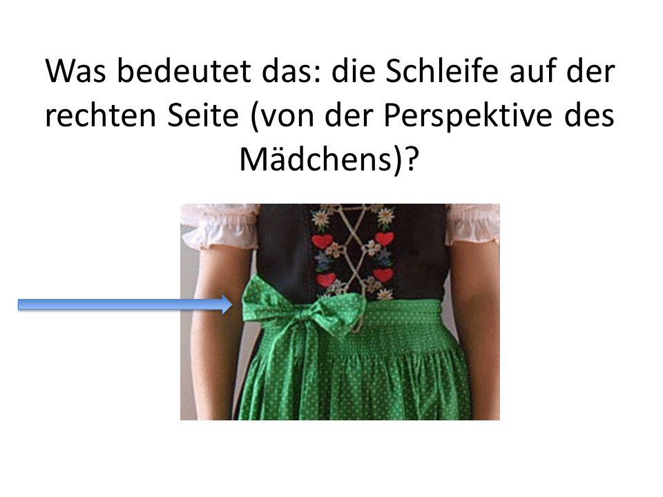Was bedeutet das: die Schleife auf der rechten Seite (von der Perspektive des Mädchens)?