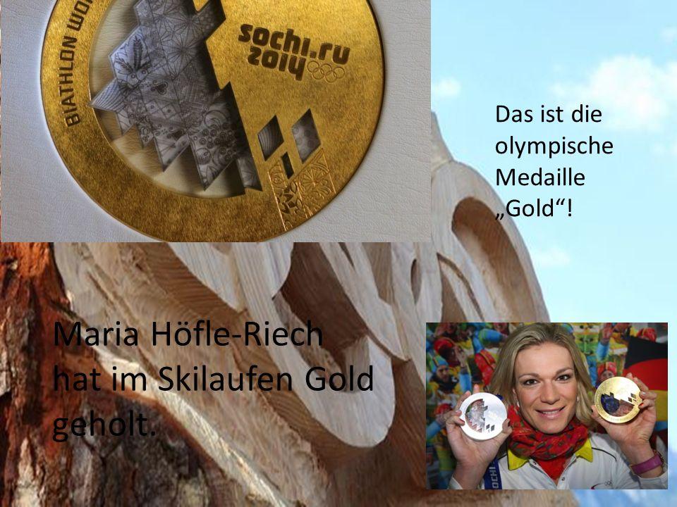 Das ist die olympische Medaille Gold! Maria Höfle-Riech hat im Skilaufen Gold geholt.