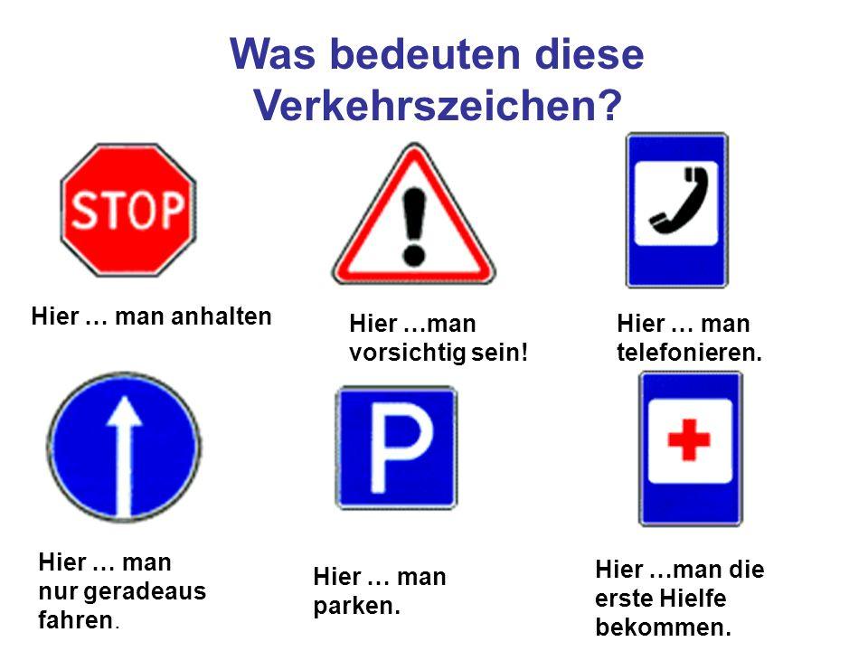 Was bedeuten diese Verkehrszeichen? Hier … man anhalten Hier …man vorsichtig sein! Hier … man telefonieren. Hier … man nur geradeaus fahren. Hier … ma
