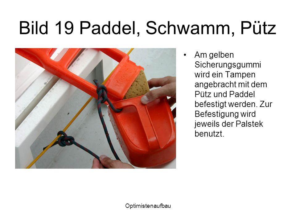 Optimistenaufbau Bild 19 Paddel, Schwamm, Pütz Am gelben Sicherungsgummi wird ein Tampen angebracht mit dem Pütz und Paddel befestigt werden. Zur Befe