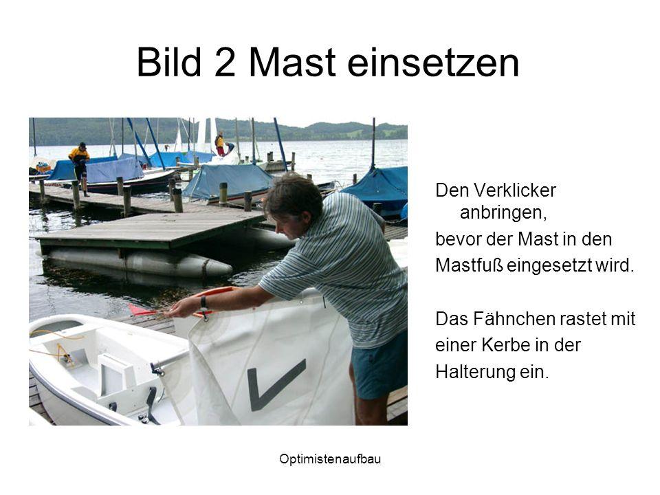 Optimistenaufbau Bild 2 Mast einsetzen Den Verklicker anbringen, bevor der Mast in den Mastfuß eingesetzt wird. Das Fähnchen rastet mit einer Kerbe in