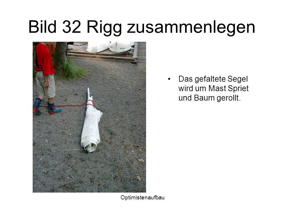 Optimistenaufbau Bild 32 Rigg zusammenlegen Das gefaltete Segel wird um Mast Spriet und Baum gerollt.