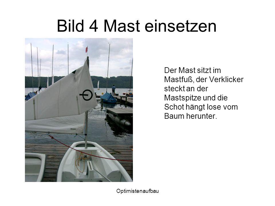 Optimistenaufbau Bild 25 Das Ruder Das Ruder wird mit den Stiften am Blatt in die Führungen am Heck eingesetzt.